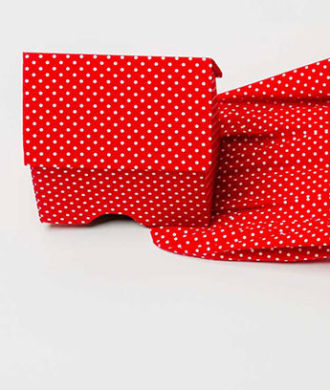 GUDA KOSTER: RED WITH WHITE DOTS