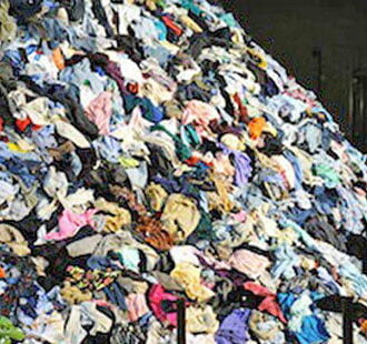 Photo credit: Christian Boltanski 'No Man's Land' exhibition, a 50 ton mountain of used clothing.