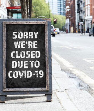 Sorry we're Closed due to Covid-19. Foldable advertising poster on the street (Photo GETTY IMAGES)